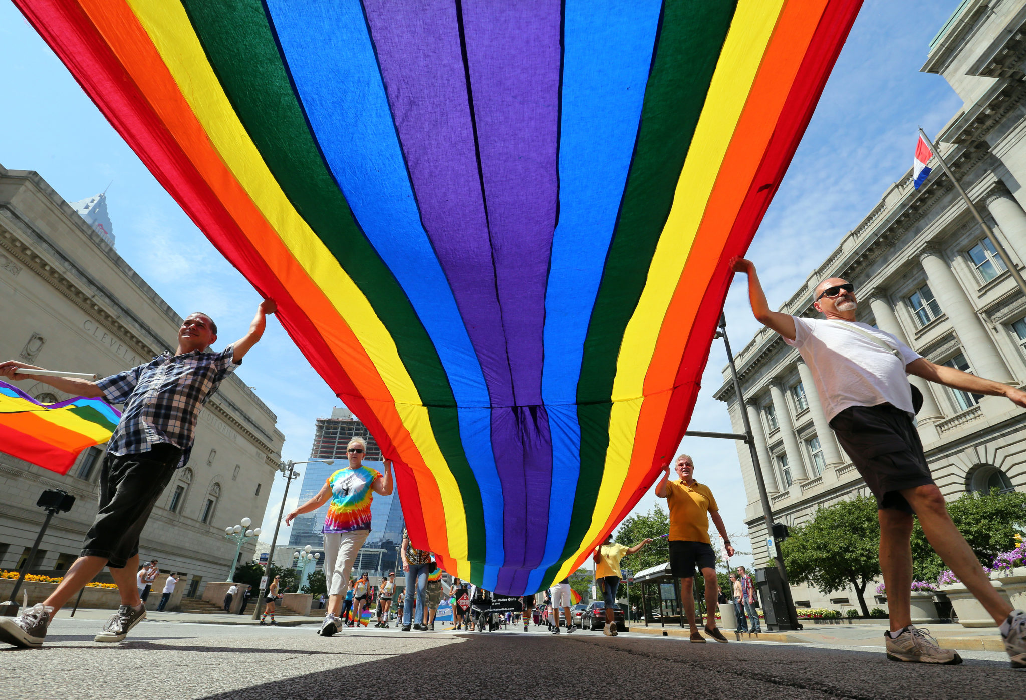***A FAVORITE Picture**** Parade Goers Carry A Huge Rainbow Flag Past City Hall On Lakeside Avenue During The 27th Annual Cleveland Pride Parade On Saturday Aug. 8, 2015. The Parade And Festival Was Billed As Cleveland Pride 2015 Rewind Because The Originally Scheduled Day Succumbed To Bad Weather In June. About 1,500 Participants Marched In The Parade East Down Lakeside Avenue And North On East Ninth Street To Voinovich Park (Lisa DeJong/The Plain Dealer) ORG XMIT: CLE1508081745339902